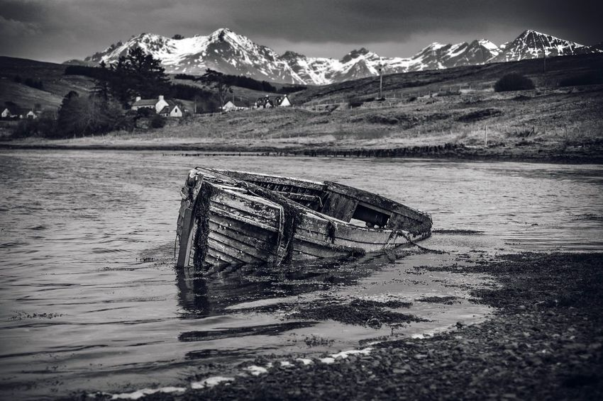 Black And White Sunken Boat Boat Wreck Fishing Boat Scotland Skye Wilderness Cullins Mountain Water Day Nature Abandoned Beauty In Nature Tranquil Scene Sky Scenics - Nature