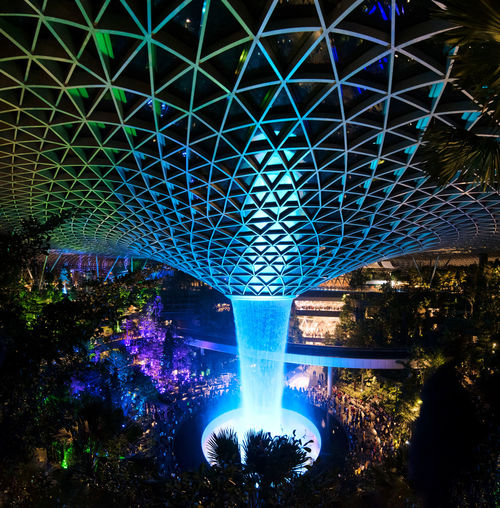 Changi Airport Singapore Jewel Vortex Water Fountain Trees Night Illuminated Blue Built Structure No People Architecture Pattern Nature Motion Tree Indoors  Glowing Lighting Equipment Bridge Long Exposure Multi Colored Light Decoration Ceiling Luxury