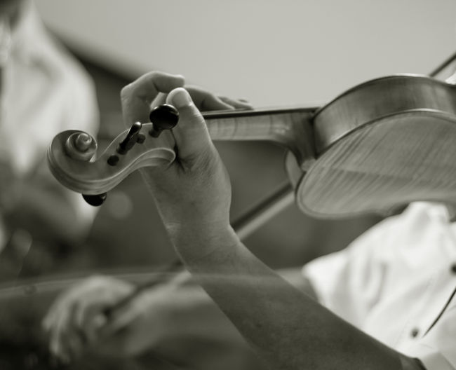 Close-Up Midsection Of Man Playing Violin