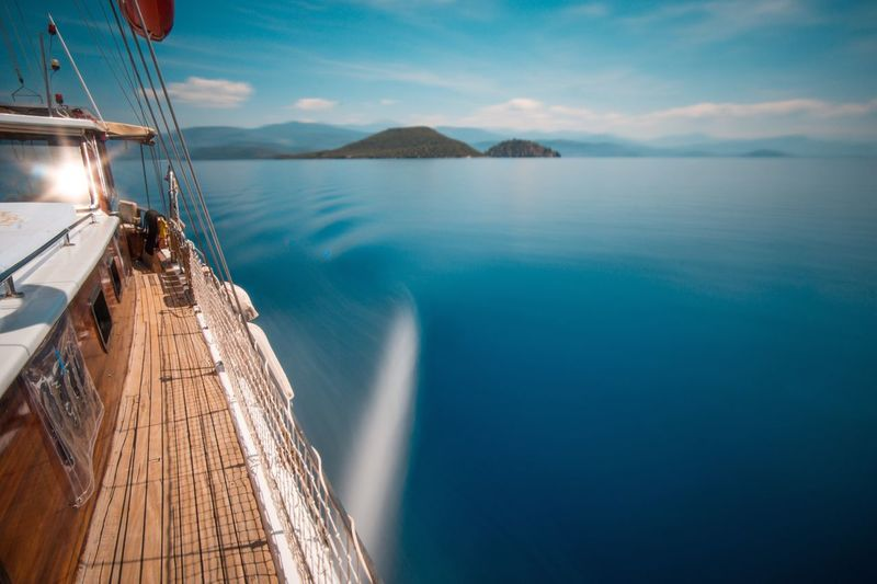 Water Sea Nautical Vessel Sky Transportation Scenics Nature Mode Of Transport Beauty In Nature Mountain Sailing Outdoors Day Tranquil Scene Waterfront No People Sailboat Blue Tranquility Horizon Over Water Blur Blurred Blurred Motion Göcek Live For The Story The Great Outdoors - 2017 EyeEm Awards
