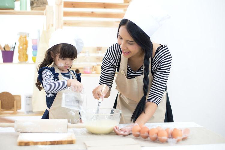 Women preparing food at home