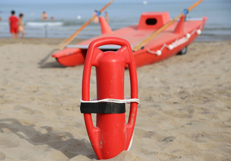 lifebuoy and lifeguard rescue boat on the seashore Bay Watch Baywatch Lıfeguard RISK Red Security Summertime Beach Equipment Inflatable  Lifebuoy Lifebuoy Station Lifeguard  Lifeguard Station Lifeguards Opcena Protection Rescue Safety Sand Sea Summer Vacation