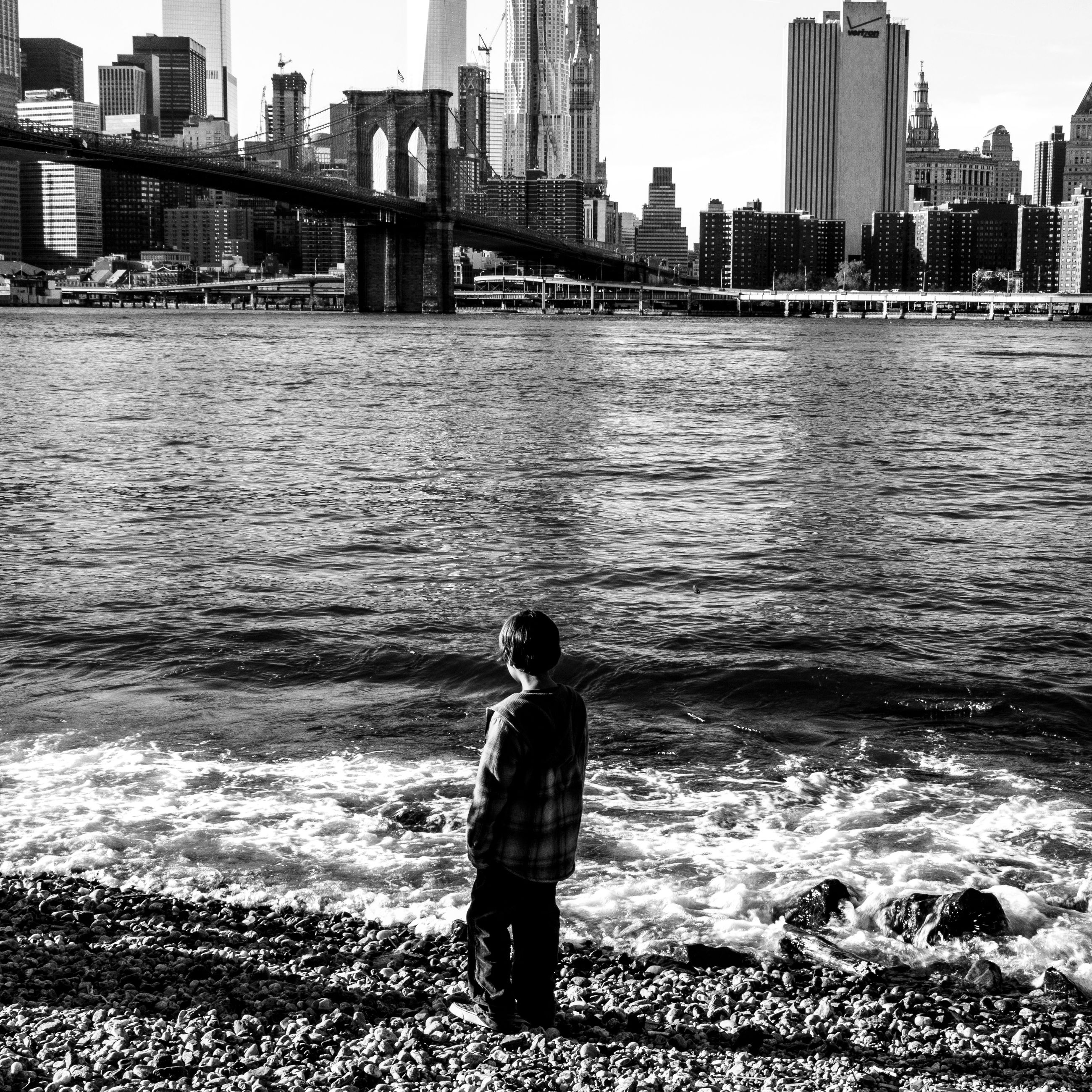 water, building exterior, architecture, built structure, city, lifestyles, leisure activity, rear view, men, standing, city life, river, full length, sea, cityscape, three quarter length, person, building