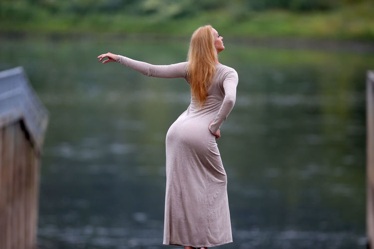 Rear view of woman standing outdoors