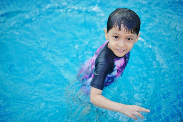 EyeEmNewHere EyeEm Kids Water Swimming Portrait Child Smiling Swimming Pool Childhood Happiness Cheerful Looking At Camera Wet Hair Poolside Water Park My Best Photo