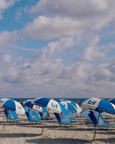 beach day Miami Beach Miami FL Usa 🇺🇸☀️ South Beach, Miami Beach Sand Outdoors Day Summer Vacations Blue Sky Sea Cloud - Sky Nature Outdoor Chair No People Tent Travel Destinations Sand Dune Modern