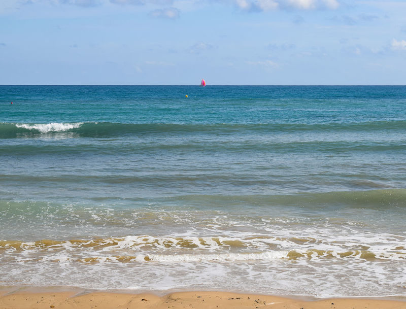 a red sail and a yellow buoy Sailboat Sailing Red Sails Turquoise Water Yellow Sand Holidays Vacations Summer Water Wave Sea Beach Sand Summer Sky Horizon Over Water Buoy Seascape Coast Shore Sandy Beach Ocean Coastline Calm