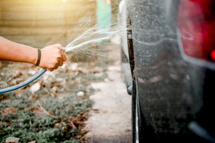 Car Wash Washing Care Child Childhood Close-up Day Domestic Domestic Animals Finger Garden Hose Hand Human Body Part Human Hand Lifestyles Mammal One Animal One Person Outdoors Pets Real People Unrecognizable Person Wheel
