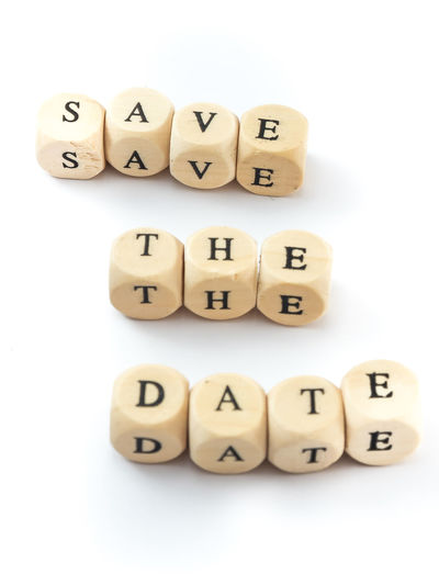 Save the Date Save The Date Alphabet Arrangement Block Capital Letter Close-up Communication Cube Shape Dice High Angle View Indoors  Letter No People Number Spelling Still Life Studio Shot Text Toy Block Western Script White Background