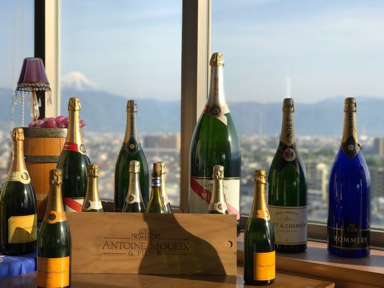 Wine bottles and Mt. Fuji 🗻🍷 Bottle Wine Bottle Glass - Material Alcohol Indoors  Still Life Table Sky Wine No People Drink Food And Drink Cork - Stopper Champagne Day Close-up Clear Sky Mt.Fuji Japan Scenics Mountain Fuji Landscape Beauty In Nature Pure Beauty