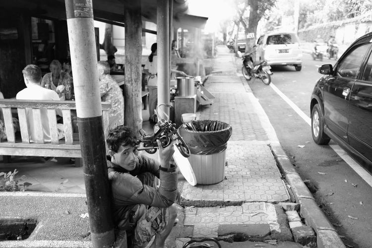 economic disparity in my neighborhood ASIA B&w Street Photography Bali Black And White Blackandwhite Despair Everybodystreet Here Belongs To Me Human Interest INDONESIA Portrait Of A Man  Street Photography Street Portrait Street Vendor Streetphotography Up Close Street Photography
