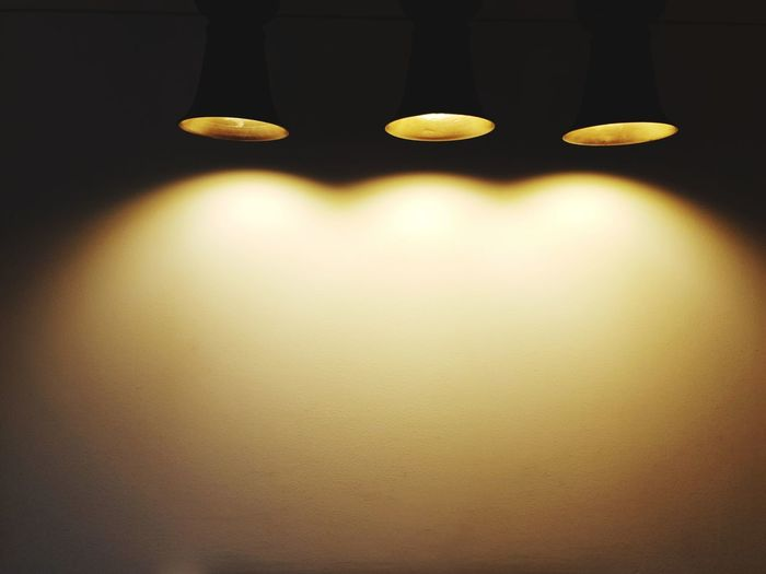 down light background for display significant message Bangkok Interior Design Bulb Light Thailand Down Light Electronic Equipment Warm Light Loft Style Minimalism Yellow Close-up