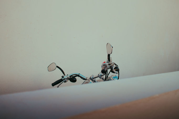 Cropped image of motorcycle against wall