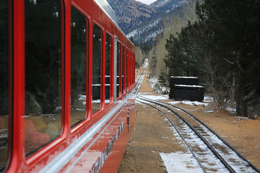 Train to Pikes Peak - world's highest Cog Railway Cog Railway Colorado Springs Diminishing Perspective Freezing Cold From A Train Window Leading Mode Of Transport Passenger Train Perspective Public Transport Public Transportation Railroad Station Railroad Station Platform Railroad Track Railway Track Red Train Snow ❄ Snowing Train Train - Vehicle Transportation Travel It's Cold Outside Winter On The Way Been There. Shades Of Winter