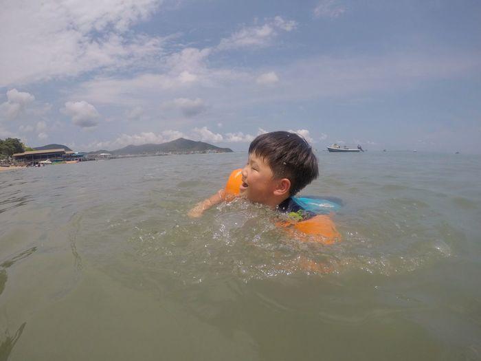 Portrait of boy swimming in sea