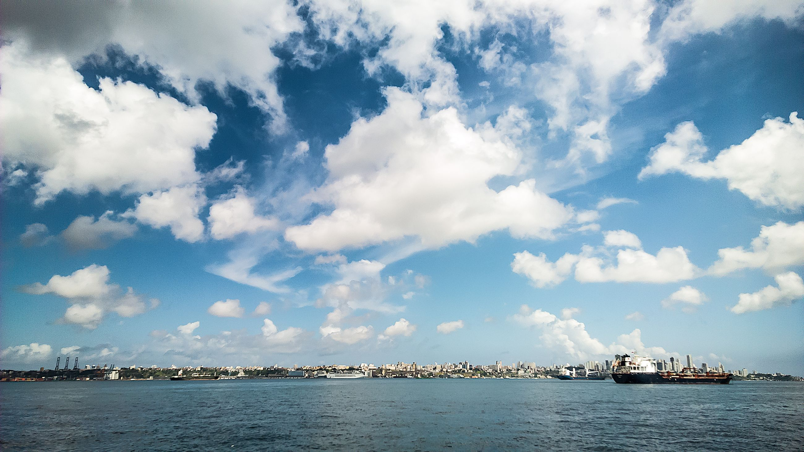 water, waterfront, sea, sky, cloud - sky, tranquility, tranquil scene, nautical vessel, scenics, nature, beauty in nature, cloud, blue, transportation, cloudy, day, rippled, outdoors, built structure, boat