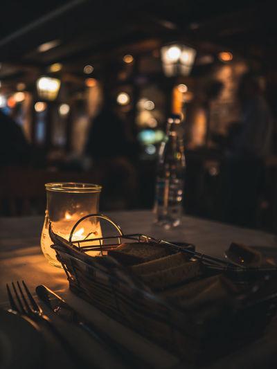 Illuminated tea light on table in restaurant