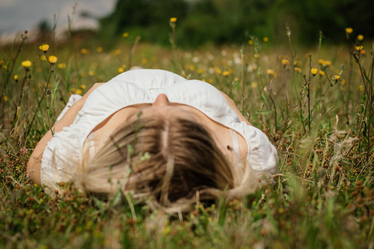 Pregnant woman laying on the gras looking in the sky White Dress Adult Grass Leisure Activity Looking In The Sky Lying Down Lying On Back One Person Outdoors Pregnant Pregnant Belly  Pregnant Phtography Selective Focus Summer Women Young Adult Young Women