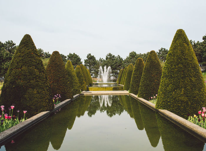 Architecture Beauty In Nature Built Structure Day Fountain Garden Growth Hedge Incidental People Nature Outdoors Park Park - Man Made Space Plant Pond Reflection Sky Topiary Tourism Travel Destinations Tree Water
