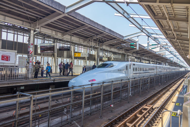 Shinkansen bullet train in Japan Train Shinkansen Shinkansen Or Bullet Train In Japan Rail Transportation Transportation Mode Of Transportation Public Transportation Group Of People Train - Vehicle Architecture Railroad Station Track Railroad Track Travel Railroad Station Platform Built Structure Real People Crowd Journey Passenger Train Large Group Of People Motion Outdoors Subway Train Station Arrival Waiting