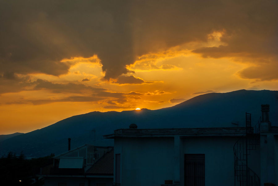 Beauty In Nature City Cloud - Sky Mountain Mountain Range No People Outdoors Silhouette Sky Sunset
