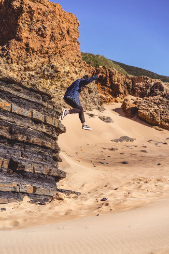 Jump Rock Parkour Jumping Off Rocks Beach Lifestyles Wild Lost Freedom Free Adventure Outdoors Clear Sky In The Air Get Lost Woman Girl person Youth Soul Romantic Dreaming Portugal Travel Exploring