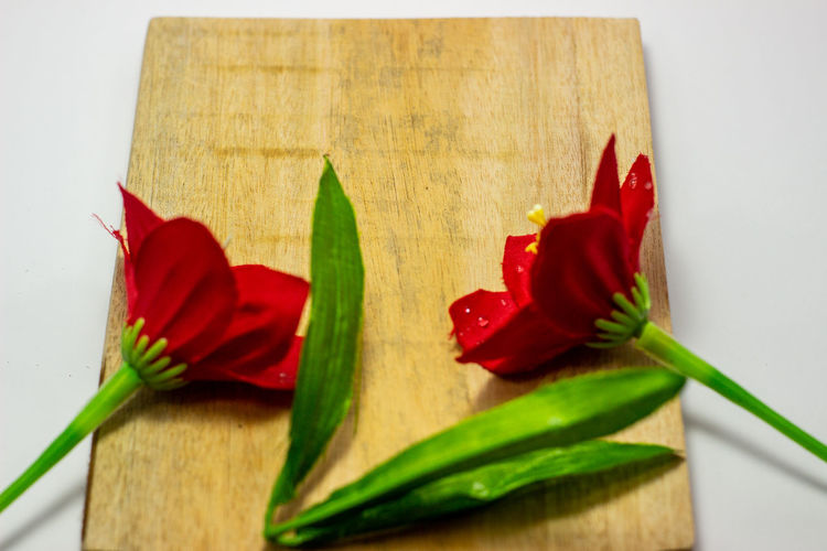 Close-up of red chili pepper on cutting board