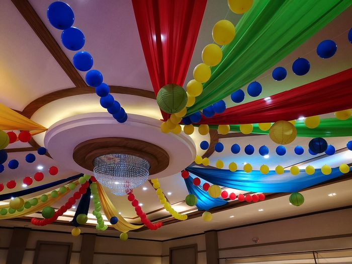 Low angle view of multi colored lanterns hanging from ceiling in building