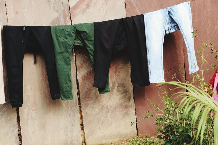 Low section of clothes drying on wood