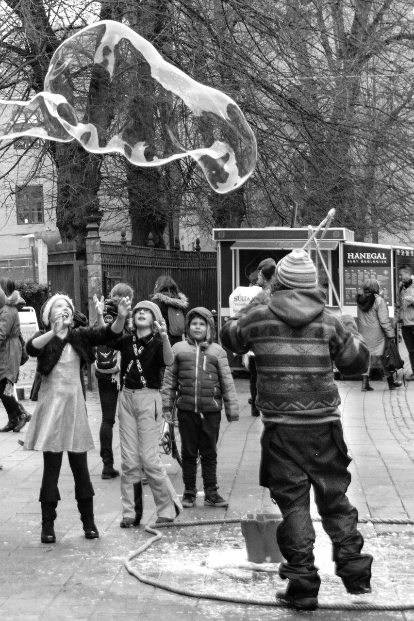 Happy children Black & White Black And White Black And White Photography Boy Child Childhood Children Fantasy Girl Happiness Happy People Joy Joyful Man Pedestrian Soap Bubble Street Street Photography Vendor Winter Wintertime