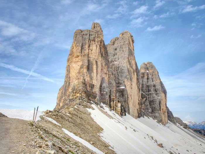 Spring on trail around tre cime di lavaredo massive. the famous mountains in dolomites. very popular