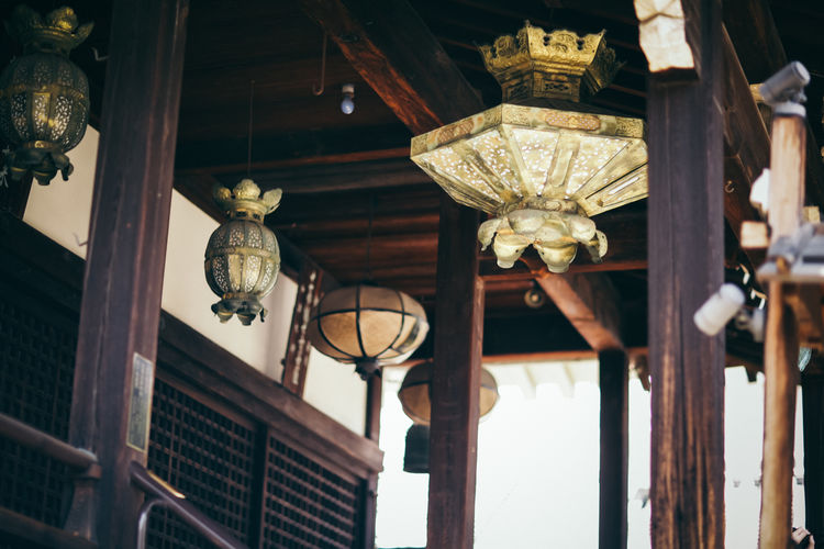 Low angle view of illuminated lanterns hanging at home