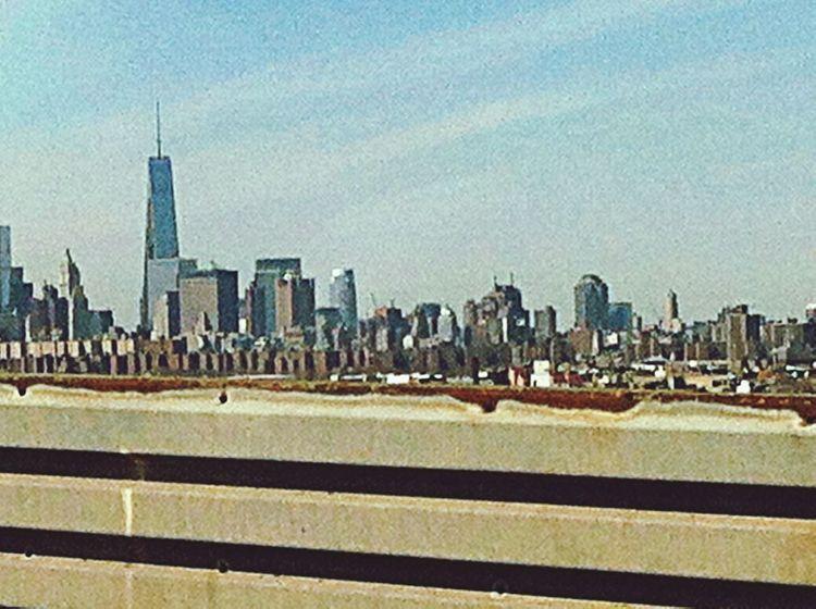 Manhattan skyline view from Kozkiusko Bridge Driving Skyline NYC