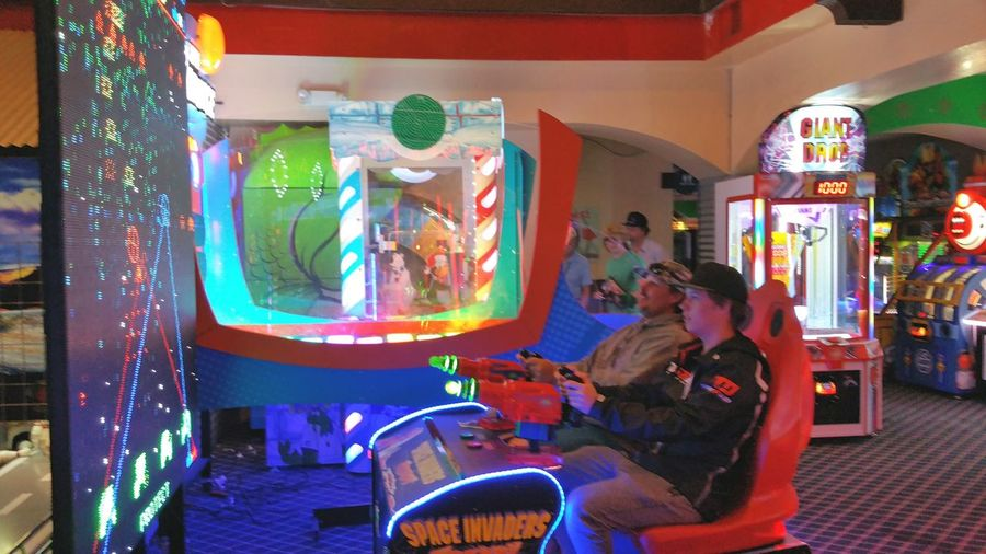 video arcade still going strong Playing Video Games Indoor Electronics Electronic Games Video Arcade City Arts Culture And Entertainment