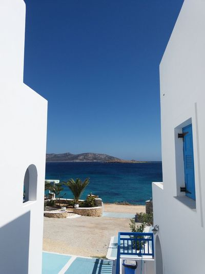 Traditional Greek houses in islands Blue Sky Blue And White Greek Islands Traveler Greece Island Koufonisia Islandstyle Casements Blue Window EyeEm Selects Sea Clear Sky Whitewashed Summer Water Sunlight Blue Sunny Sky