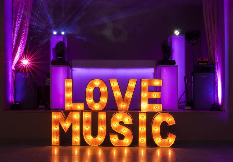 Illuminated Love Music Text In Darkroom