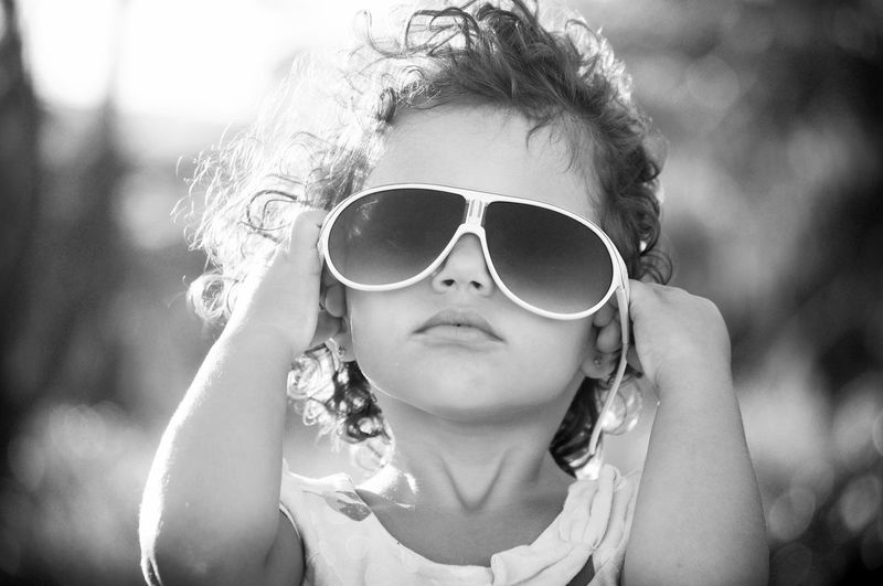 Portrait Of Cute Girl Wearing Sunglasses