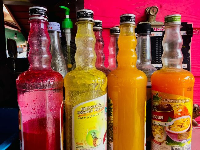 Container Bottle Multi Colored Variation Indoors  Drink Choice Food And Drink Text Glass - Material Side By Side Close-up No People Refreshment Still Life In A Row Communication Arrangement For Sale Alcohol