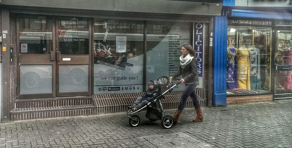 A Womans Work Is Never Done... Portrait Of A Woman People Watching Hdr Edit Pushchair Walking Alone... Where Are You Going? Beautiful Stranger Mother Street Photography