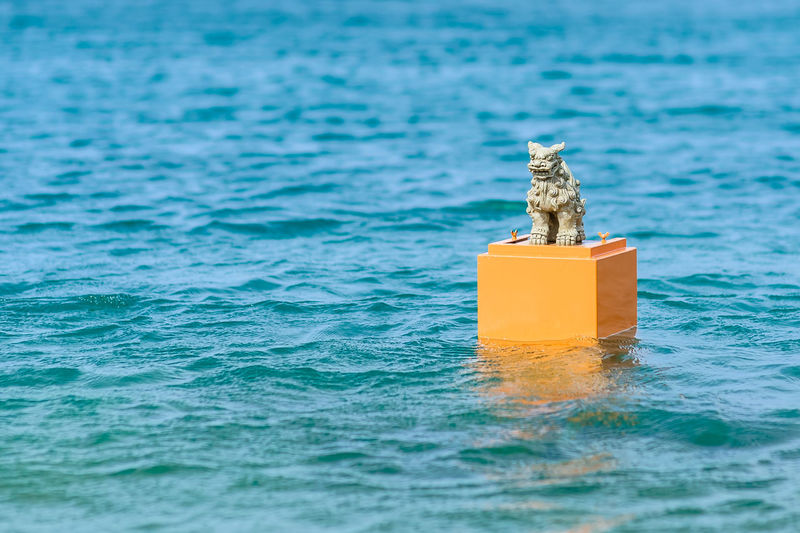 Animal sculpture in sea