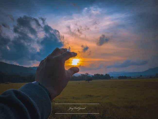Sunset is love Human Hand Hand One Person Sky Cloud - Sky Real People EyeEmNewHere Sunset Human Body Part Finger Scenics - Nature Non-urban Scene Orange Color Unrecognizable Person Beauty In Nature Personal Perspective Lifestyles Nature Holding Leisure Activity Land