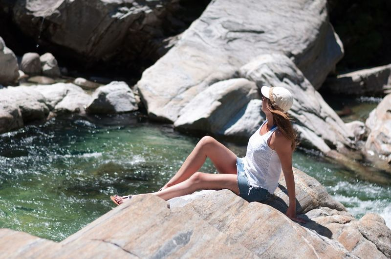 Taking sun and enjoying clear water at valle Verzasca, Tessin, CH Rock - Object Only Women One Woman Only One Young Woman Only Long Hair Beautiful Woman Vendor Eye4photography  Portrait Portrait Of A Woman Full Length Young Women Summer Switzerland Beauty Eyemphotography Real People EyeEmBestPics Side View Springtime
