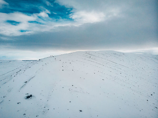 Walking on the crater DJI X Eyeem Mavic Air Arid Climate Beauty In Nature Climate Cloud - Sky Cold Temperature Covering Crater Day Environment Land Landscape Mountain Nature Non-urban Scene People Scenics - Nature Sky Snow Snowcapped Mountain Tranquil Scene Tranquility White Color Winter