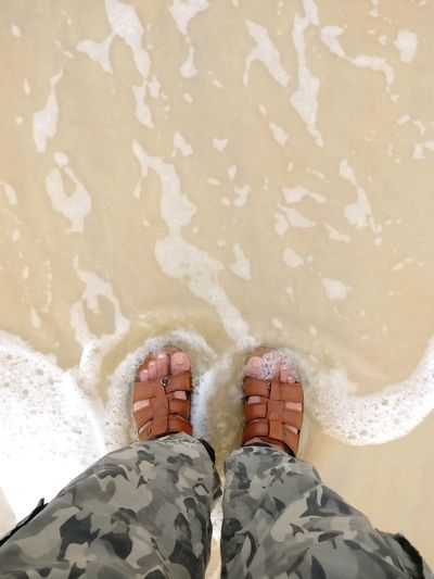 Beach time. Foam Camouflage Clothing Sandy Beach Vacation Holidays Travel Travel And Leisure Personal Perspective Beach Time Beach View Splash View From Above Low Section Water Sea Men Beach Sand Standing Human Leg Sunlight Shoe Flip-flop Pair Slipper  Footwear Feet Rushing Wave Things That Go Together