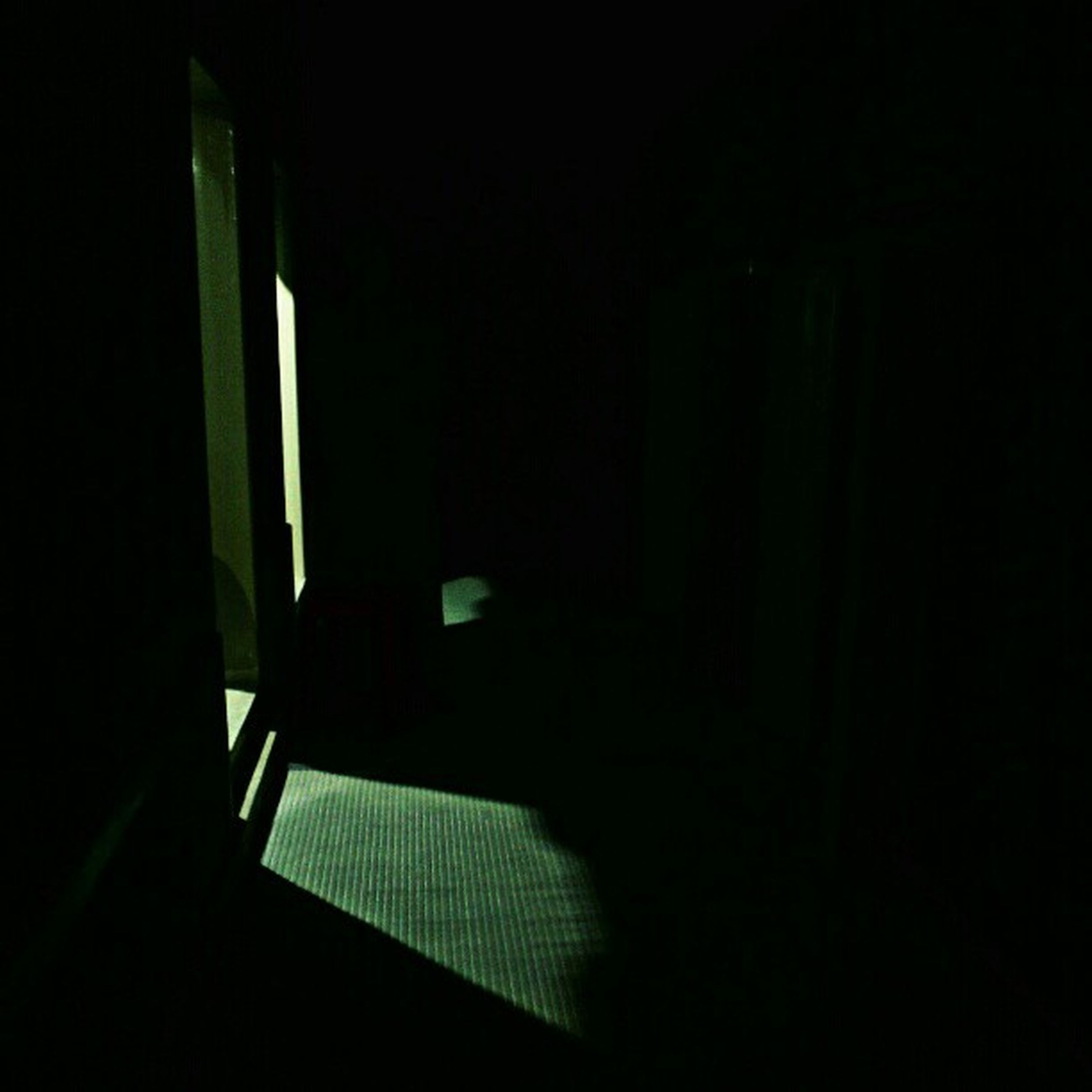 indoors, dark, built structure, copy space, architecture, home interior, darkroom, window, illuminated, house, shadow, wall - building feature, night, no people, light - natural phenomenon, sunlight, wall, room, absence, darkness