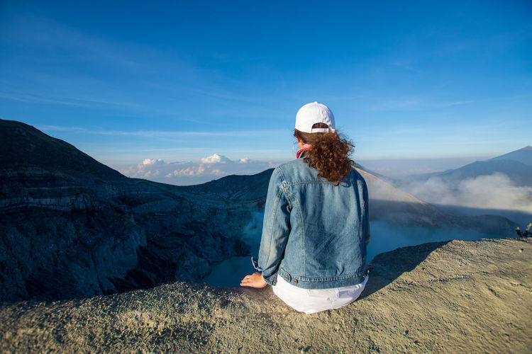 INDONESIA Beauty In Nature Blue Casual Clothing Clothing Day Hairstyle Kawah Ijen Leisure Activity Lifestyles Mountain Mountain Range Nature Non-urban Scene One Person Outdoors Real People Rear View Scenics - Nature Sky Standing Tourism Tranquil Scene Tranquility Travel Destinations Women