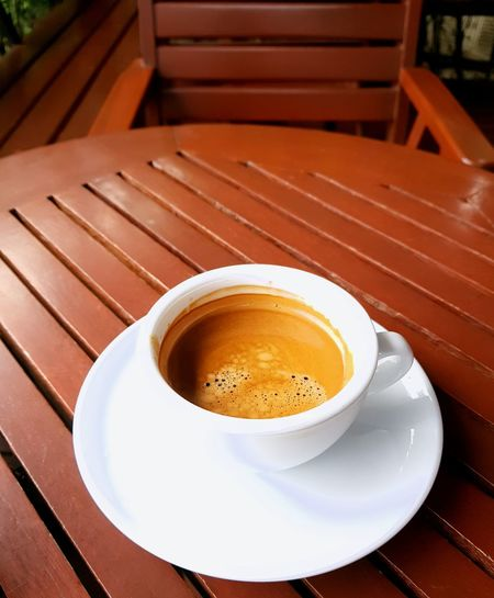 hot coffee on wood table Drink Frothy Drink Cappuccino Saucer Table Coffee - Drink Coffee Break Cafe Coffee Cup Close-up Hot Drink Espresso Caffeine Black Coffee Served Coffee
