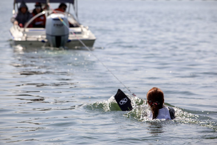Woman waterskiing on lake