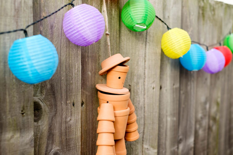 Close-up of toys hanging on wood