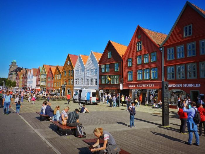 Bergen Houses Norway Adult Architecture Blue Building Building Exterior Built Structure City Clear Sky Crowd Day Group Of People Housefront Large Group Of People Lifestyles Men Nature Real People Sky Street Women